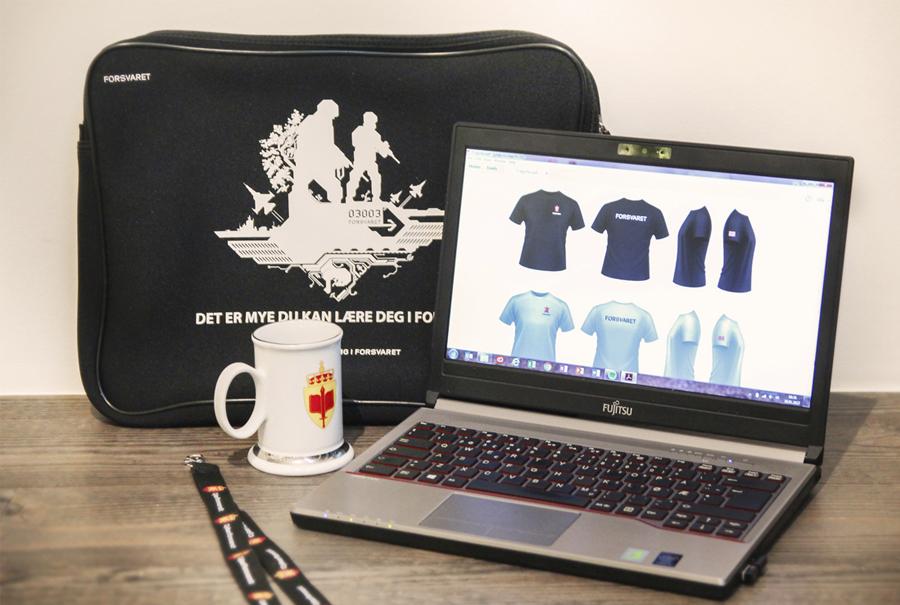 Design av t-skjorter og reklameartikler til Forsvaret. laptop etui med logo, termokopp Lifeventure med logo, headnceker med logo, t-skjorte med trykk, krus med logo, nøkkelbånd med logo